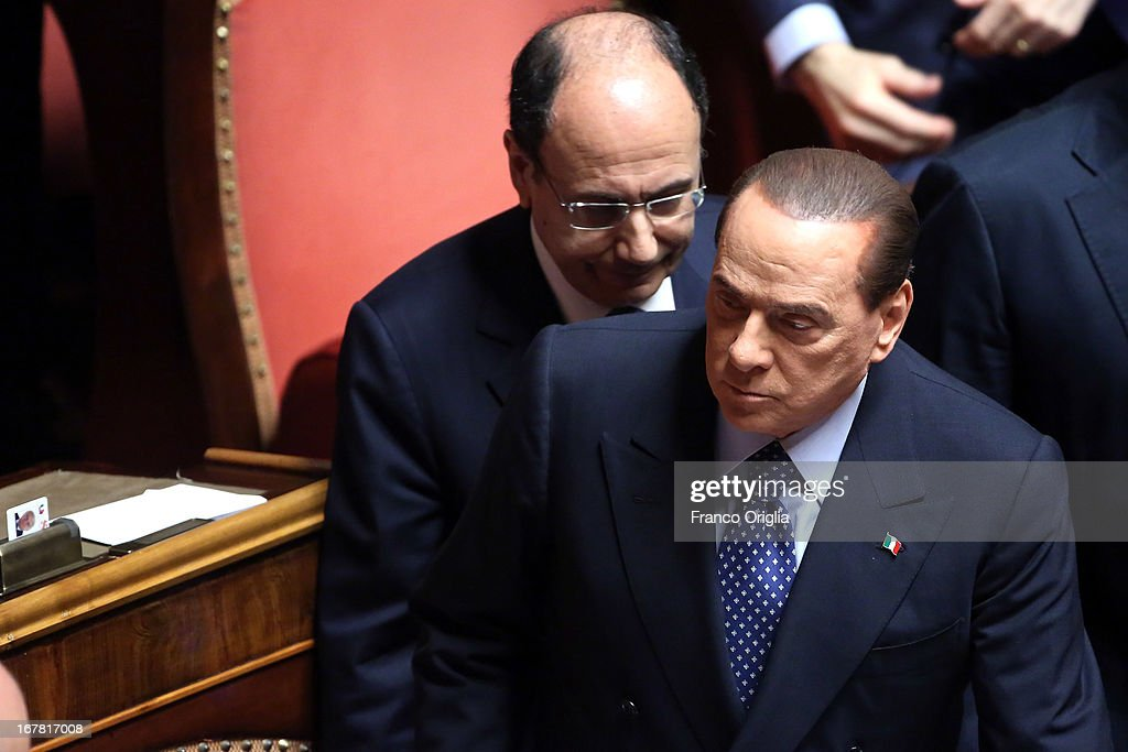 <a gi-track='captionPersonalityLinkClicked' href=/galleries/search?phrase=Silvio+Berlusconi&family=editorial&specificpeople=201842 ng-click='$event.stopPropagation()'>Silvio Berlusconi</a> (R) and former president of the Senate <a gi-track='captionPersonalityLinkClicked' href=/galleries/search?phrase=Renato+Schifani&family=editorial&specificpeople=4851265 ng-click='$event.stopPropagation()'>Renato Schifani</a> (L) attend the confidence vote at the Senate on April 30, 2013 in Rome, Italy. The new coalition government was formed through extensive cooperation agreements between the right and left coalitions after a two-month long post-election deadlock.