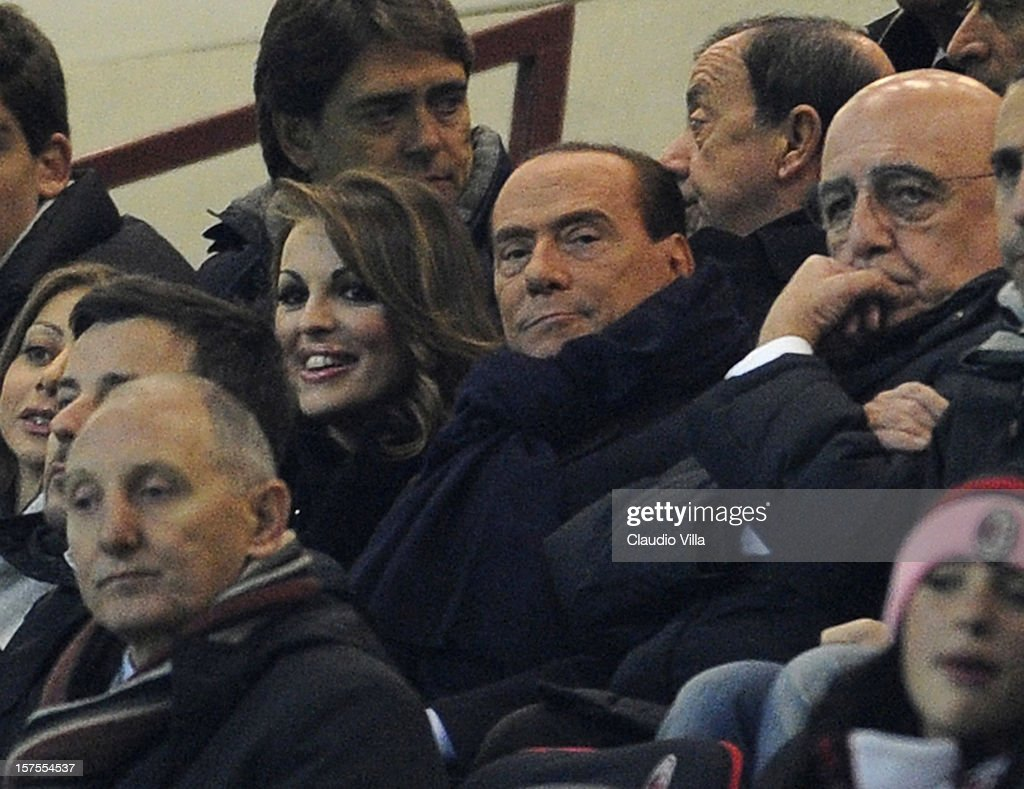 Silvio Berlusconi and Francesca Pascale (L) attend the UEFA Champions League group C match between AC Milan and Zenit St Petersburg at San Siro Stadium on December 4, 2012 in Milan, Italy.