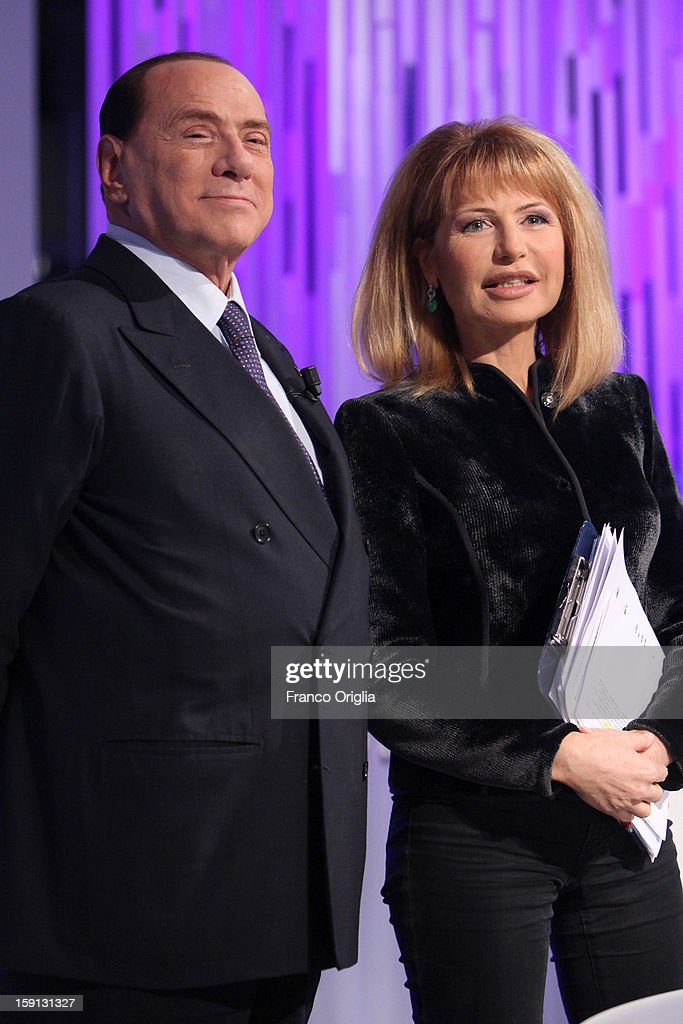 <a gi-track='captionPersonalityLinkClicked' href=/galleries/search?phrase=Silvio+Berlusconi&family=editorial&specificpeople=201842 ng-click='$event.stopPropagation()'>Silvio Berlusconi</a> and tv conductor Lilli Gruber attends 'Otto e Mezzo' Italian TV show on January 8, 2013 in Rome, Italy. The former Italian prime minister Berlusconi will lead his centre-right coalition during the Italian elections with a new alliance with the Northern League party .