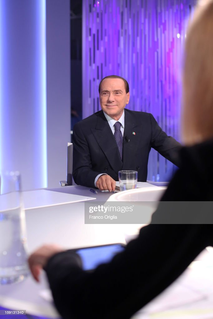 Silvio Berlusconi and tv conductor Lilli Gruber attends 'Otto e Mezzo' Italian TV show on January 8, 2013 in Rome, Italy. The former Italian prime minister Berlusconi will lead his centre-right coalition during the Italian elections with a new alliance with the Northern League party .