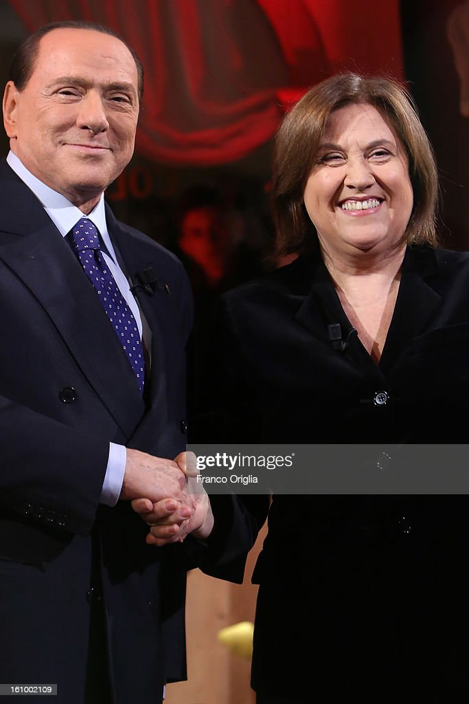 Silvio Berlusconi and TV conductor Lucia Annunziata pose on the set of the Italian TV talk show Leader on February 8, 2013 in Rome, Italy. The former Italian prime minister will lead his centre-right coalition during the Italian elections scheduled for February 24.