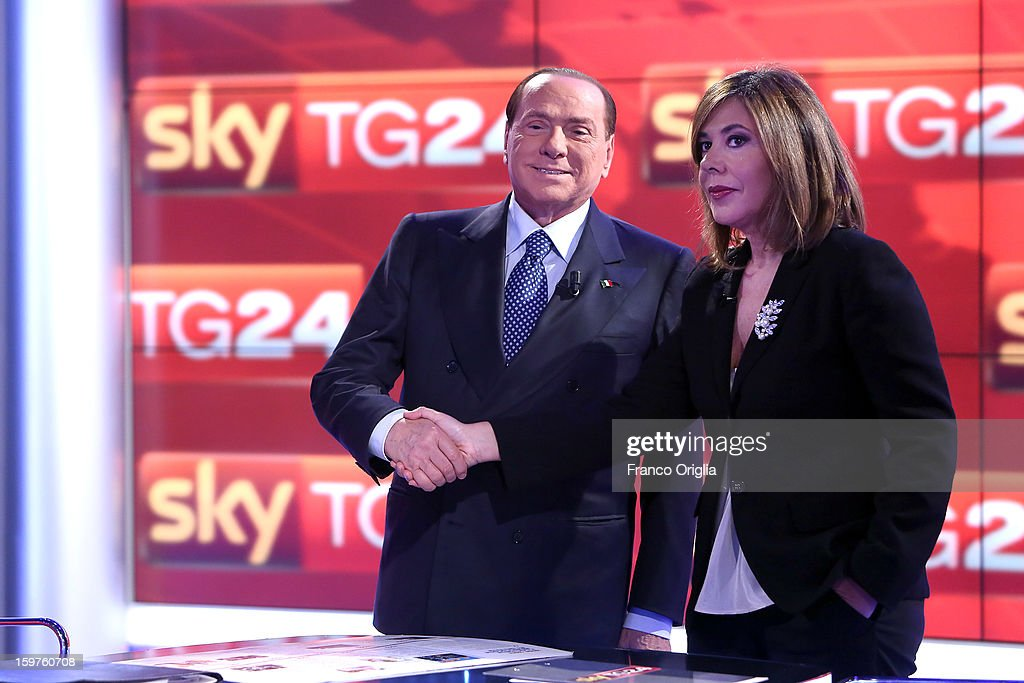 <a gi-track='captionPersonalityLinkClicked' href=/galleries/search?phrase=Silvio+Berlusconi&family=editorial&specificpeople=201842 ng-click='$event.stopPropagation()'>Silvio Berlusconi</a> (L) and tv conductor Maria Latella appear on Sky TG24 on January 20, 2013 in Rome, Italy. The former Italian prime minister Berlusconi will lead his centre-right coalition during the Italian elections with a new alliance with the Northern League party. The court in Milan recently denied Berlsuconi's recent request to halt his trial for accusations of having sex with an under-age prostitute.