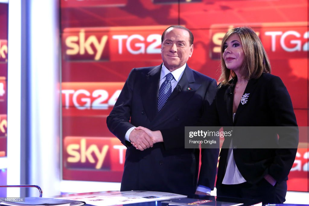 Silvio Berlusconi (L) and tv conductor Maria Latella appear on Sky TG24 on January 20, 2013 in Rome, Italy. The former Italian prime minister Berlusconi will lead his centre-right coalition during the Italian elections with a new alliance with the Northern League party. The court in Milan recently denied Berlsuconi's recent request to halt his trial for accusations of having sex with an under-age prostitute.