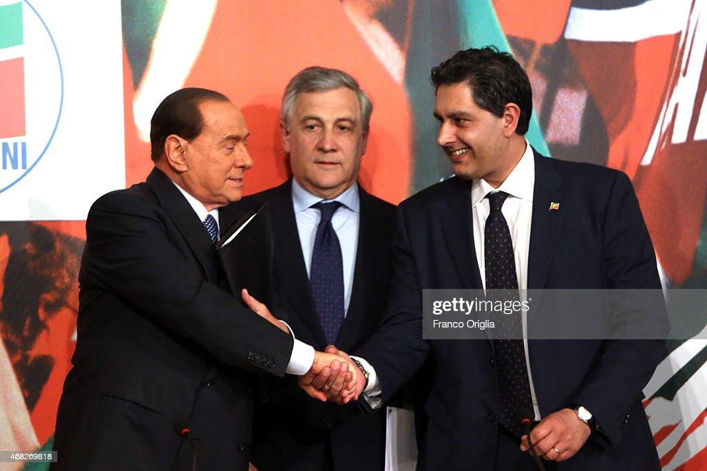 <a gi-track='captionPersonalityLinkClicked' href=/galleries/search?phrase=Silvio+Berlusconi&family=editorial&specificpeople=201842 ng-click='$event.stopPropagation()'>Silvio Berlusconi</a> <a gi-track='captionPersonalityLinkClicked' href=/galleries/search?phrase=Antonio+Tajani&family=editorial&specificpeople=5429212 ng-click='$event.stopPropagation()'>Antonio Tajani</a> and Giovanni Toti attend a press conference to open the European electoral campaign of Berlusconi's party Forza Italia at the Forza Italia headquarters on April 18, 2014 in Rome, Italy.