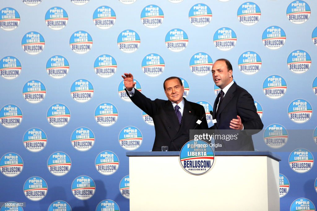 <a gi-track='captionPersonalityLinkClicked' href=/galleries/search?phrase=Silvio+Berlusconi&family=editorial&specificpeople=201842 ng-click='$event.stopPropagation()'>Silvio Berlusconi</a> (L), flanked by the secretary general of Popolo della Liberta (PDL) party <a gi-track='captionPersonalityLinkClicked' href=/galleries/search?phrase=Angelino+Alfano&family=editorial&specificpeople=5101299 ng-click='$event.stopPropagation()'>Angelino Alfano</a> (R), attends a meeting with candidates ahead of the upcoming elections in Italy at the Capranica Hall on January 25, 2013 in Rome, Italy. The former Italian prime minister Berlusconi will lead his centre-right coalition during the Italian elections scheduled for February 24.
