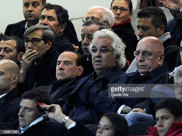 Silvio Berlusconi Flavio Briatore and Adriano Galliani attend the UEFA Champions League group C match between AC Milan and Malaga CF at Stadio...