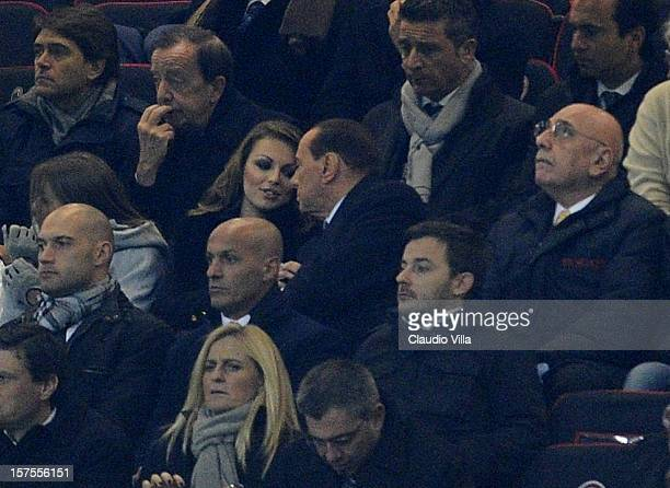 Silvio Berlusconi Francesca Pascale and Adriano Galliani attend the UEFA Champions League group C match between AC Milan and Zenit St Petersburg at...