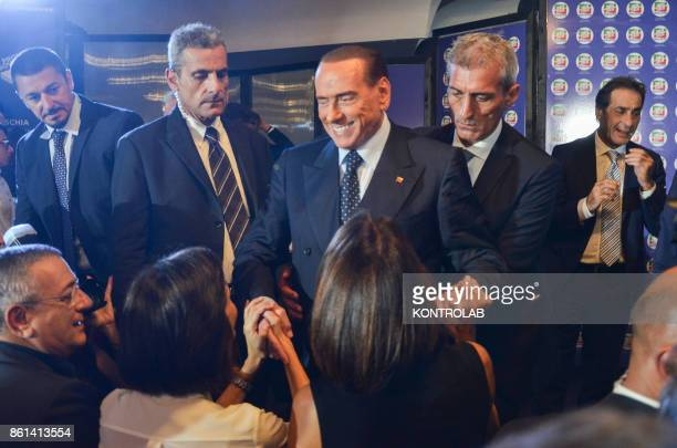 Silvio Berlusconi greets supporters in Ischia southern Italy during the convention of Forza Italia