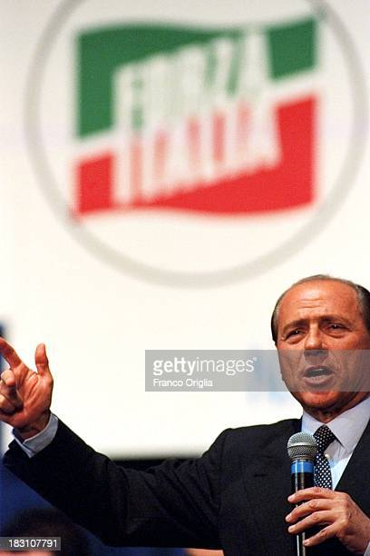 Silvio Berlusconi holds a speech during a centerright coalition rally for the general elections campaign in the Southern region of Campania in the...