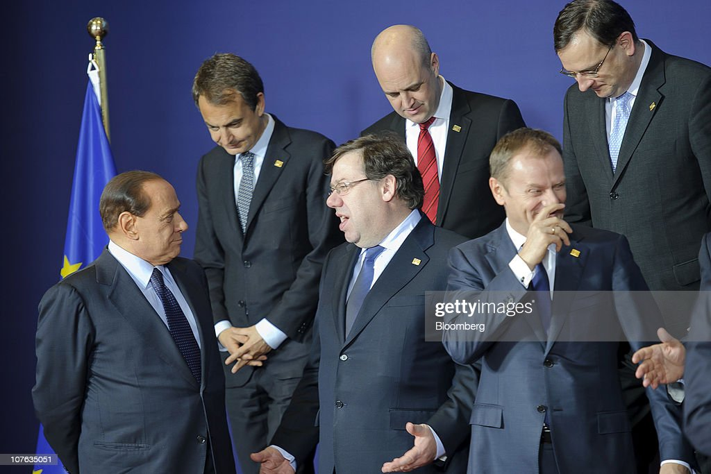 <a gi-track='captionPersonalityLinkClicked' href=/galleries/search?phrase=Silvio+Berlusconi&family=editorial&specificpeople=201842 ng-click='$event.stopPropagation()'>Silvio Berlusconi</a>, Italy's prime minister, from left, Jose Zapatero, Spain's prime minister, <a gi-track='captionPersonalityLinkClicked' href=/galleries/search?phrase=Brian+Cowen&family=editorial&specificpeople=5128895 ng-click='$event.stopPropagation()'>Brian Cowen</a>, Ireland's prime minister, <a gi-track='captionPersonalityLinkClicked' href=/galleries/search?phrase=Fredrik+Reinfeldt&family=editorial&specificpeople=861728 ng-click='$event.stopPropagation()'>Fredrik Reinfeldt</a>, Sweden's prime minister, <a gi-track='captionPersonalityLinkClicked' href=/galleries/search?phrase=Donald+Tusk&family=editorial&specificpeople=870281 ng-click='$event.stopPropagation()'>Donald Tusk</a>, Poland's prime minister, and <a gi-track='captionPersonalityLinkClicked' href=/galleries/search?phrase=Petr+Necas&family=editorial&specificpeople=3014277 ng-click='$event.stopPropagation()'>Petr Necas</a>, prime minister of the Czech Republic, speak as European Union leaders gather for the family photograph during the EU summit at the European Council headquarters in Brussels, Belgium, on Thursday, Dec. 16, 2010. European Union divisions widened over how to contain the debt contagion that threatens the euro, limiting a summit starting today to agreeing on a crisis-management mechanism that takes effect in 2013. Photographer: Jock Fistick/Bloomberg via Getty Images
