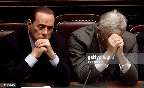 Silvio Berlusconi Italy's prime minister left and Giulio Tremonti Italy's finance minister listen after an address to parliament's chamber of...