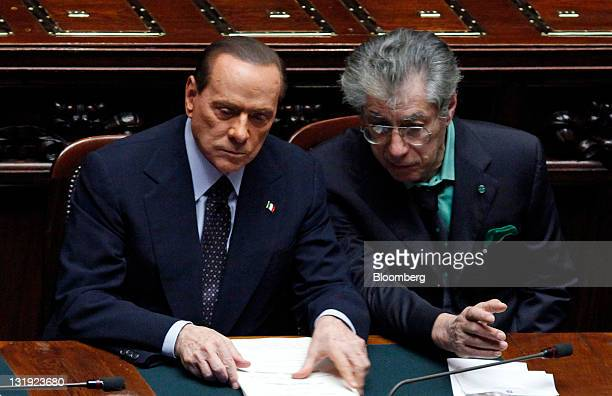 Silvio Berlusconi Italy's prime minister left and Umberto Bossi leader of Italy's Northern League party attend a voting session on last year's budget...