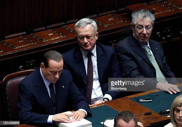 Silvio Berlusconi Italy's prime minister left Giulio Tremonti Italy's finance minister center and Umberto Bossi leader of Italy's Northern League...