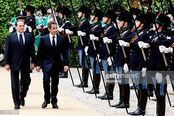 Silvio Berlusconi Italy's prime minister left walks with Nicolas Sarkozy France's president as they inspect the honour guard ahead of a bilateral...