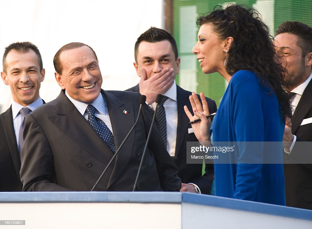 Silvio Berlusconi jokes with Angela Bruno employee of Green Power during his campaigning in the Venice Province on February 9, 2013 in Venice, Italy. Berlusconi is entering the last week of campaigning for his centre-right coalition party Popolo della Liberta. Italians go to the polls on February 24 and 25.