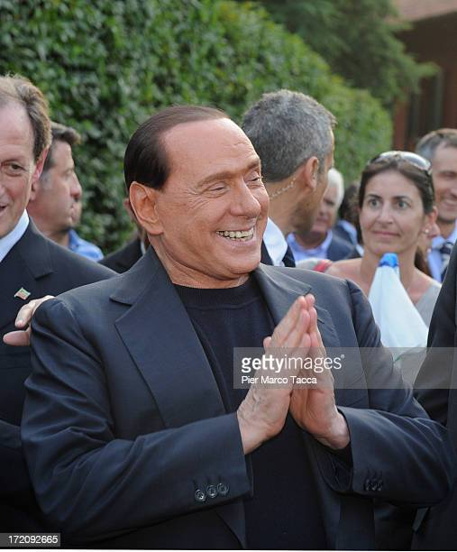 Silvio Berlusconi leader of People of freedom political party hails his supporters in front of his house Villa San Martino on July 1 2013 in Milan...