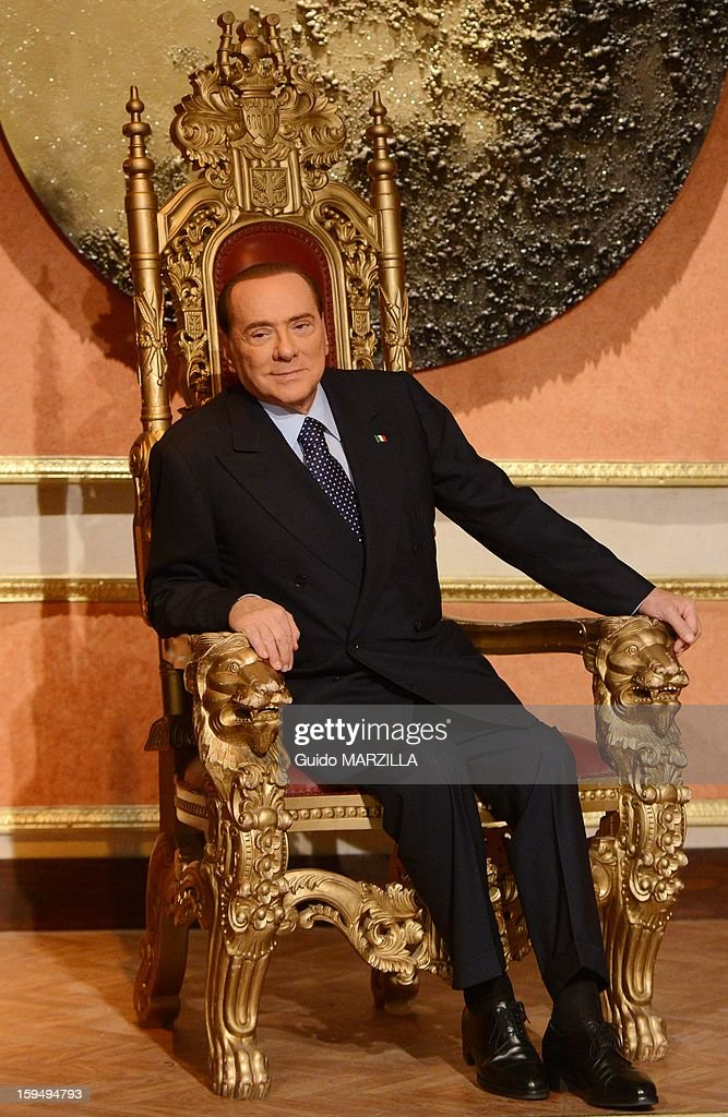 Silvio Berlusconi, leader of the Center-right Party PDL in the next italian elections poses, sat on a fake throne prior the beginning of an italian Tv show on January 11, 2013 in Rome, Italy.