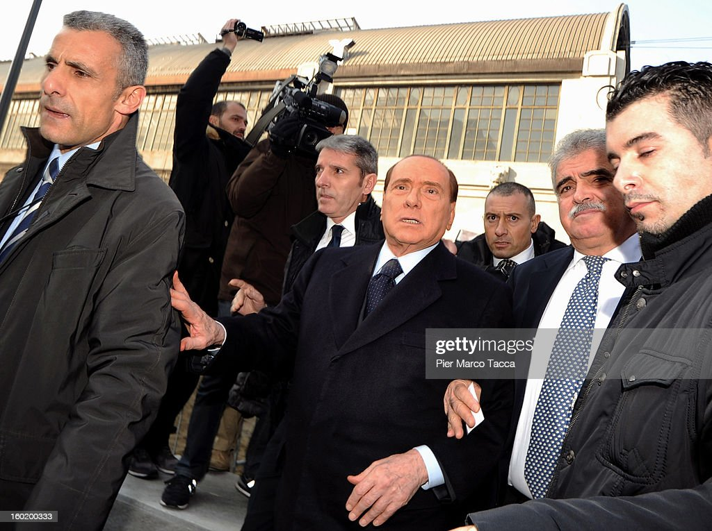 <a gi-track='captionPersonalityLinkClicked' href=/galleries/search?phrase=Silvio+Berlusconi&family=editorial&specificpeople=201842 ng-click='$event.stopPropagation()'>Silvio Berlusconi</a> leaves after attending the opening of 'Memoriale della Shoa' on International Holocaust Remembrance Day on January 27, 2013 in Milan, Italy. 'Memoriale della Shoa' is located at Platform 21 (Binario 21), which formed part of a secret underground rail network that transported hundreds of Jews to camps such as Auschwitz and Dachau, from1943 to 1945.