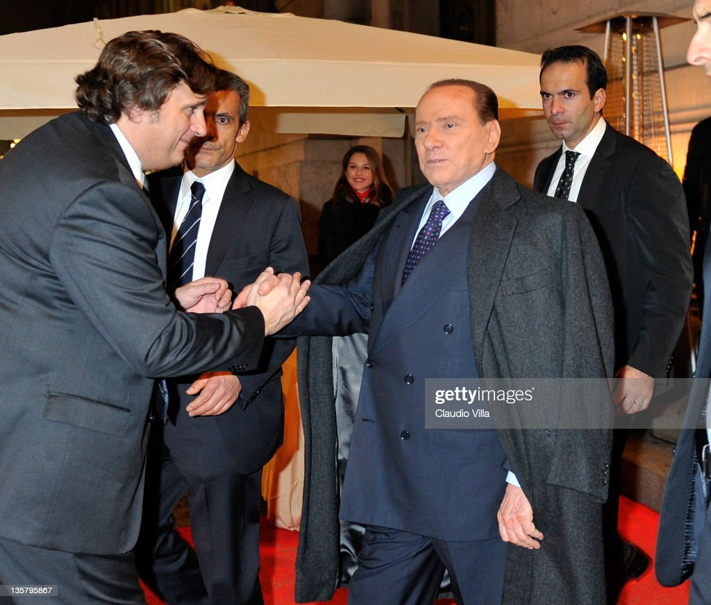 Silvio Berlusconi leaves after the AC Milan Christmas Party at the Royal Pavilion at the Central Station on December 14, 2011 in Milan, Italy.