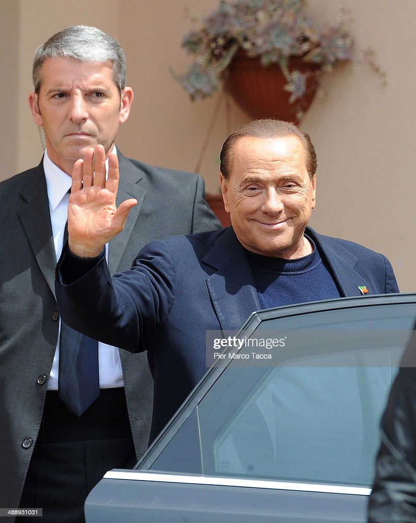 Silvio Berlusconi leaves the Fondazione Sacra Famiglia on May 9, 2014 in Milan, Italy. Today Silvio Berlusconi starts his community service for tax fraud at Fondazione Sacra Famiglia in Cesano Boscone.