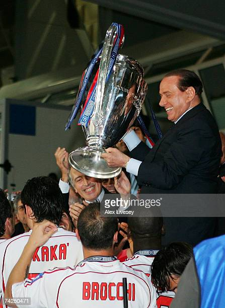 Silvio Berlusconi the Club president of Milan holds the trophy aloft following his teams 21 victory during the UEFA Champions League Final match...