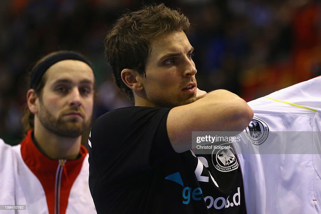 Silvio Heinevetter and Adrian Pfahl of Germany look dejected after the premilary group A match between Tunisia and Germany at Palacio de Deportes de Granollers on January 13, 2013 in Granollers, Spain. The match between Tunisia and Germany ended 25-23.