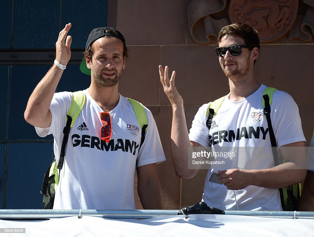 Silvio Heinevetter and Hendrik Pekeler celebrate during the German Olympic Team Welcome Home Reception on August 23 2016 in Frankfurt am MaIN GERMANY