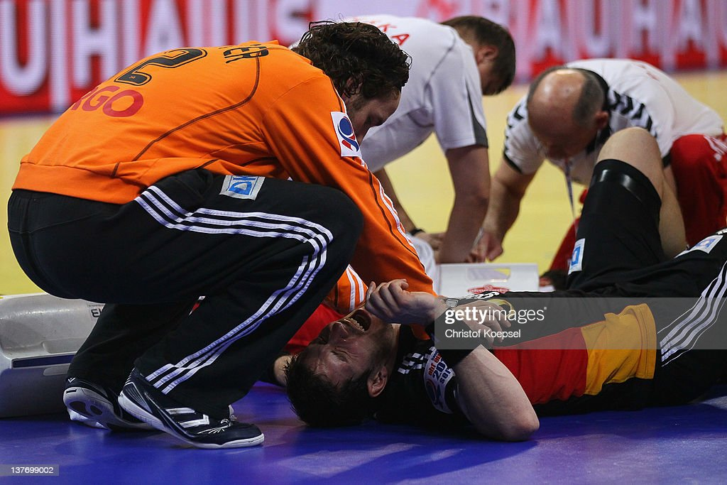 <a gi-track='captionPersonalityLinkClicked' href=/galleries/search?phrase=Silvio+Heinevetter&family=editorial&specificpeople=640249 ng-click='$event.stopPropagation()'>Silvio Heinevetter</a> cares of the injured <a gi-track='captionPersonalityLinkClicked' href=/galleries/search?phrase=Michael+Haass&family=editorial&specificpeople=821007 ng-click='$event.stopPropagation()'>Michael Haass</a> of Germany during the Men's European Handball Championship second round group one match between Poland and Germany at Beogradska Arena on January 25, 2012 in Belgrade, Serbia.