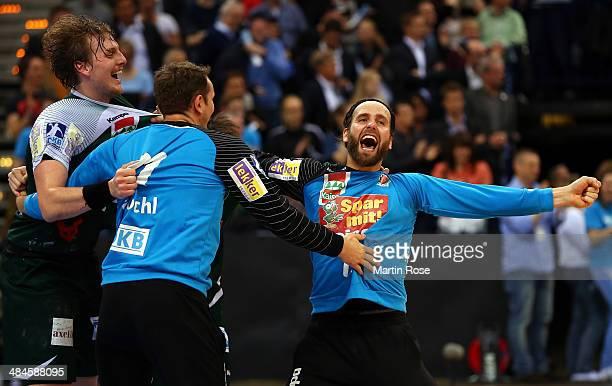 Silvio Heinevetter goalkeeper of Berlin celebrate with his team mates after winning the DHB Pokal handball final match between Flensburg Handewitt...