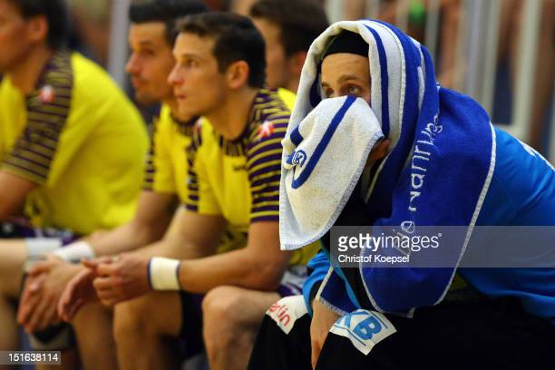 Silvio Heinevetter of Berlin sits on the bench during the DKB Handball Bundesliga match between TUSEM Essen and Fueches Berlin at the Sportpark Am...