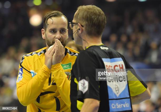 Silvio Heinevetter of Fuechse Berlin and referee Lars Geipel during the game between Fuechse Berlin and the HC Erlangen on September 12 2017 in...