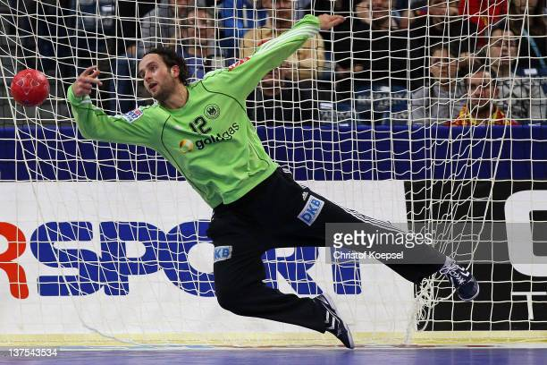 Silvio Heinevetter of Germany gets a goal during the Men's European Handball Championship second round group one match between Serbia anhd Germany at...