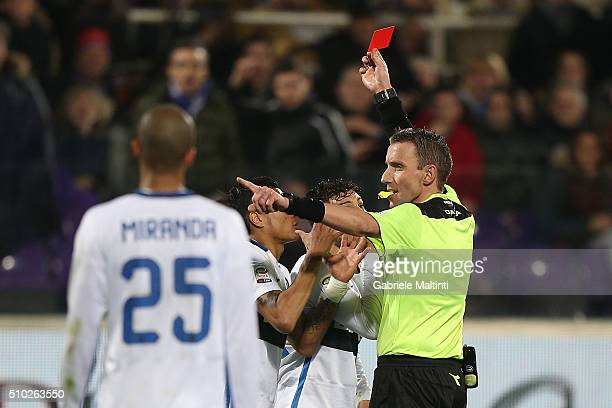 Silvio Mazzoleni referee shows a red card to Alex Tello of FC Internazionale Milano during the Serie A match between ACF Fiorentina and FC...