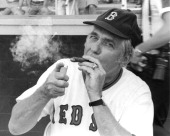 Silvio O Conte RMass lights a victory cigar after Republicans won the 1975 Congressional Baseball game