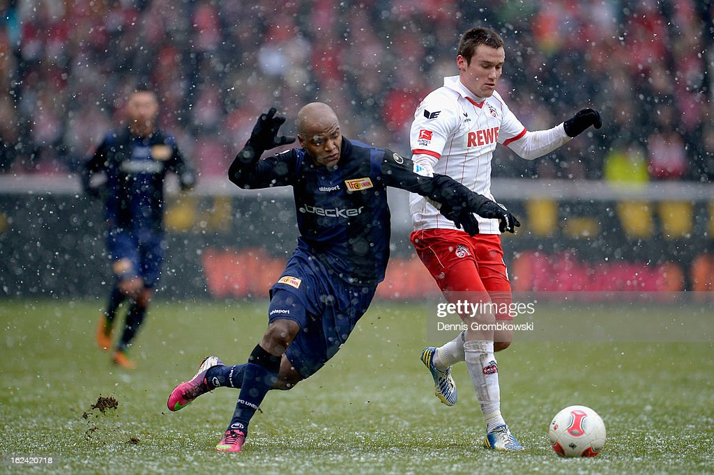 Silvio of Berlin and Christian Clemens of Cologne battle for the ball during the Second Bundesliga match between 1. FC Koeln and Union Berlin at RheinEnergieStadion on February 23, 2013 in Cologne, Germany.