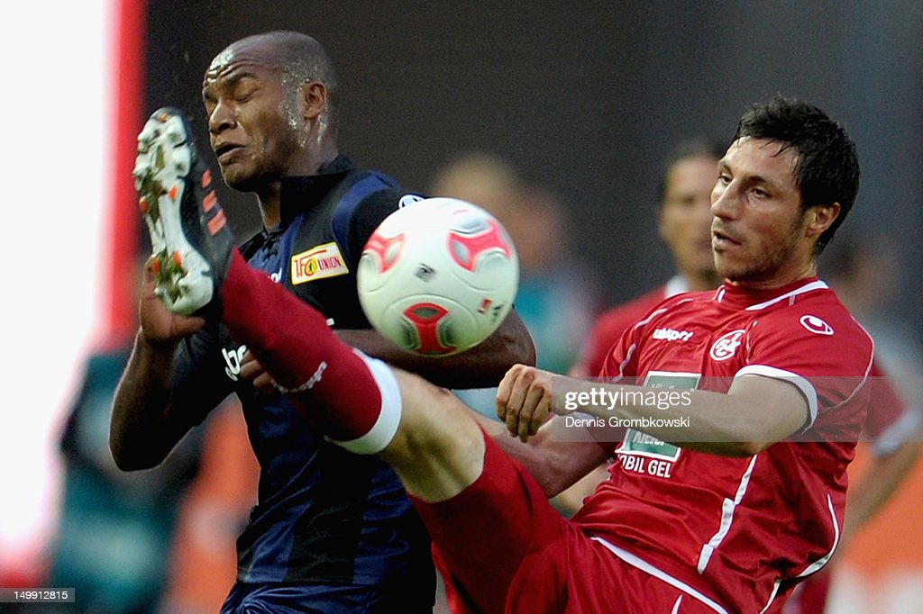 Silvio of Berlin and Mathias Abel of Kaiserslautern battle for the ball during the Second Bundesliga match between 1 FC Kaiserslautern and Union...