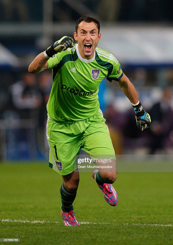 Silvio Proto of Anderlecht celebrates as Andy Najar (not pictured) scores their first goal during the UEFA Champions League Group D match between RSC Anderlecht and Arsenal at Constant Vanden Stock Stadium on October 22, 2014 in Brussels, Belgium.