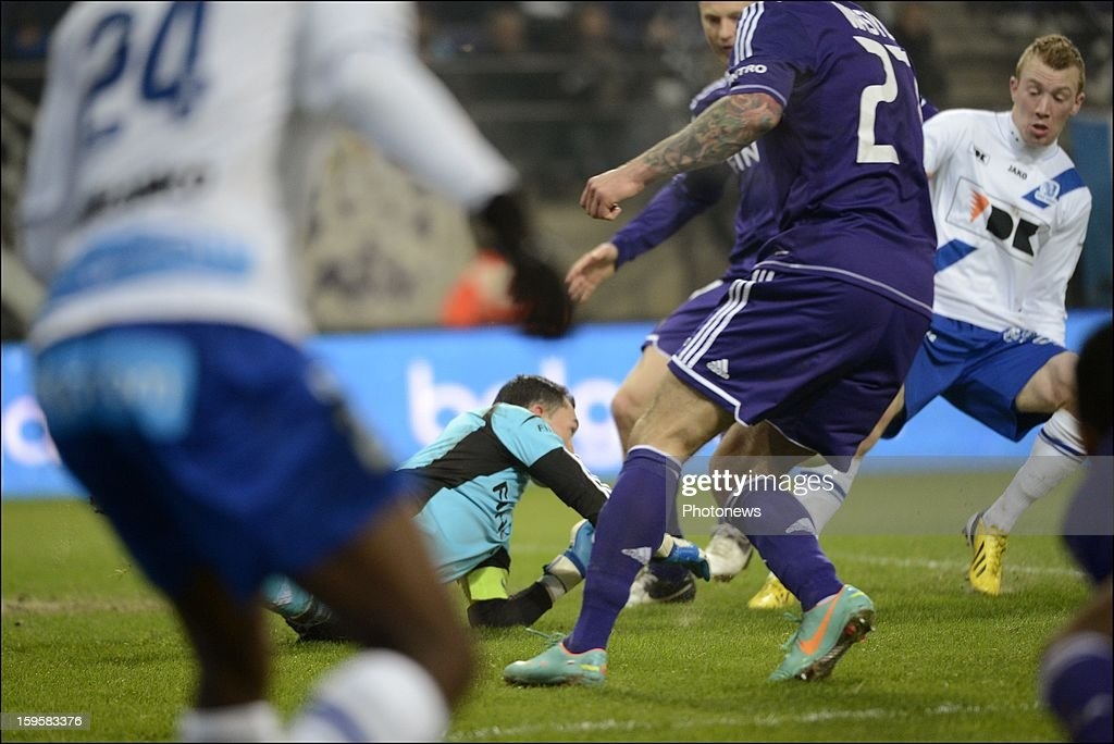 Silvio Proto of RSC Anderlecht and Christian Bruls of KAA Gent in action during the Cofidis Cup match between Rsc Anderlecht and Kaa Gent on January 16, 2013 in Anderlecht , Belgium.