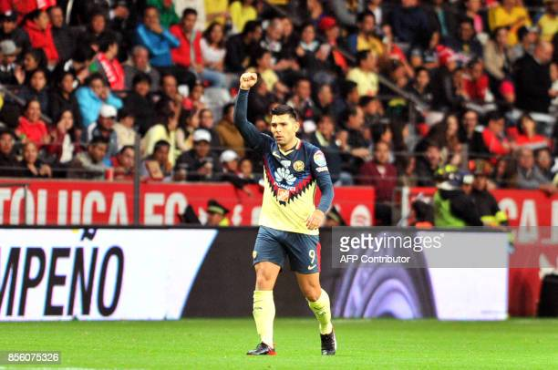 Silvio Romero of America celebrates after scoring against Toluca during their Mexican Apertura football tournament match at the Nemesio Diez stadium...