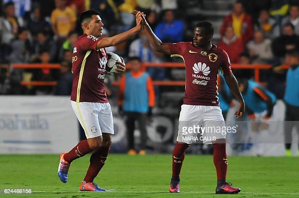 Silvio Romero of America celebrates his goal against Pachuca with his teammate Gil Buron during their Mexican Apertura 2016 Tournament football match...