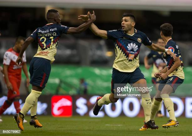 Silvio Romero of America celebrates with teammate Darwin Quintero after scoring his team's first goal during the eighth round match between America...