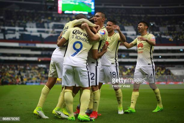 Silvio Romero of America celebrates with teammates after scoring the first goal of his team during the 14th round match between America and Queretaro...
