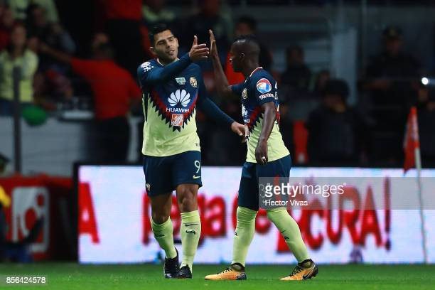 Silvio Romero of America celebrates with teammates after scoring the first goal of his team during the 12th round match between Toluca and America as...