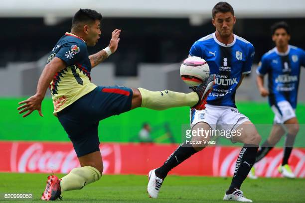 Silvio Romero of America struggles for the ball with Hiram Mier of Queretaro during the 1st round match between America and Queretaro as part of the...