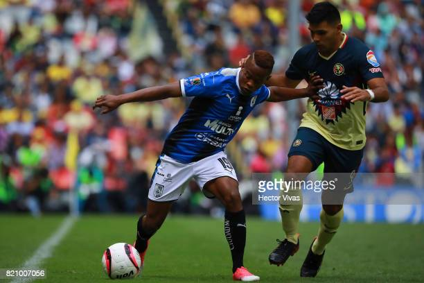Silvio Romero of America struggles for the ball with Yerson Candelo of Queretaro during the 1st round match between America and Queretaro as part of...
