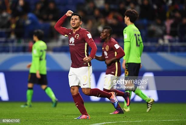 Silvio Romero of Club America celebrates scoring his team's opening goal during the FIFA Club World Cup second round match between Jeonbuk Hyundai...