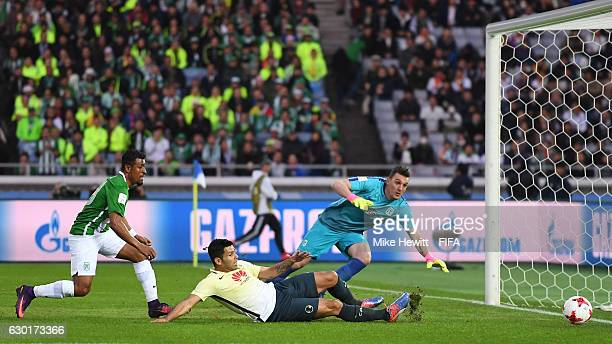Silvio Romero of Club America shoots wide as Roderick Miller Molina of Atletico Nacional looks on during the FIFA Club World Cup 3rd Place match...