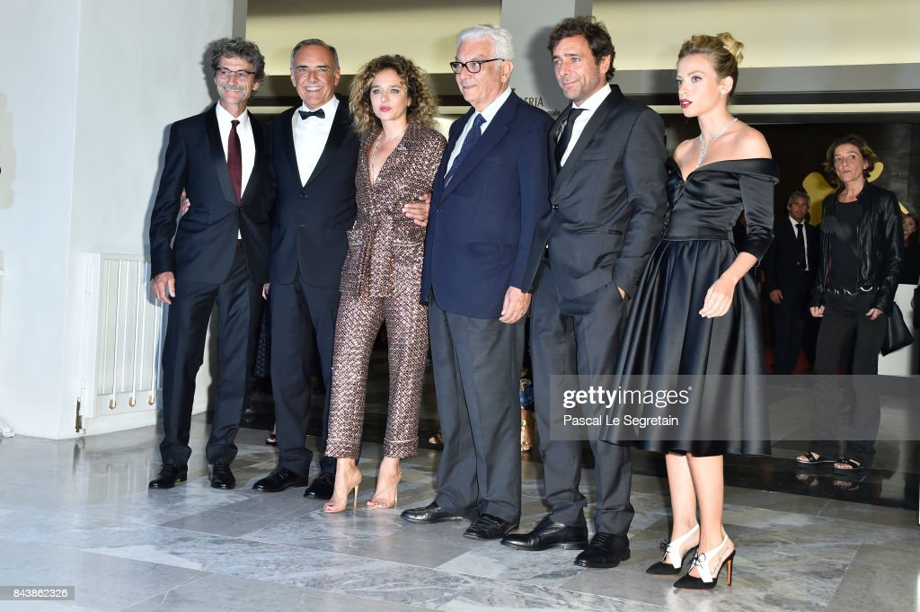 Silvio Soldini, Alberto Barbera, Valeria Golino, Paolo Baratta, Adriano Giannini and Laura Adriani walks the red carpet ahead of the 'Emma (Il Colore Nascosto Delle Cose)' screening during the 74th Venice Film Festival at Sala Grande on September 7, 2017 in Venice, Italy.