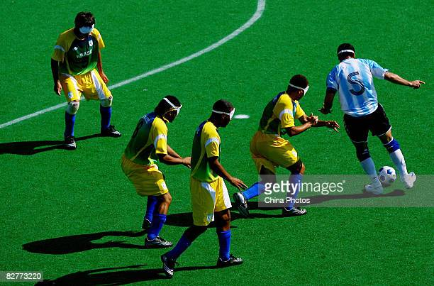 Silvio Velo of Argentina competes in the FiveASide Football match between Argentina and Brazil at Olympic Green Hockey Field B during day five of the...