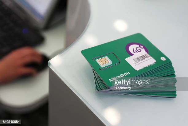 Sim cards for 4G network use sit in a pile ahead of sale inside a MegaFon PJSC mobile phone store in Moscow Russia on Tuesday Aug 29 2017 MegaFon...